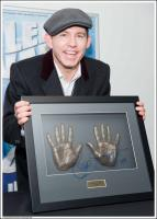 Lee Evans with handprints